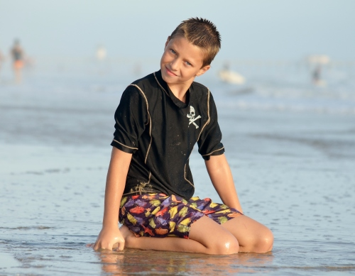 One of my sons, enjoying the beach.  Picture also by me.