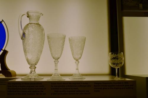 These glasses reminded me of the ones my mother collected, and I took the picture for her. They are gorgeous, and amazing examples of hand-etched glass work.  Also, they were taken of glass, through glass, so I felt it met the challenge.